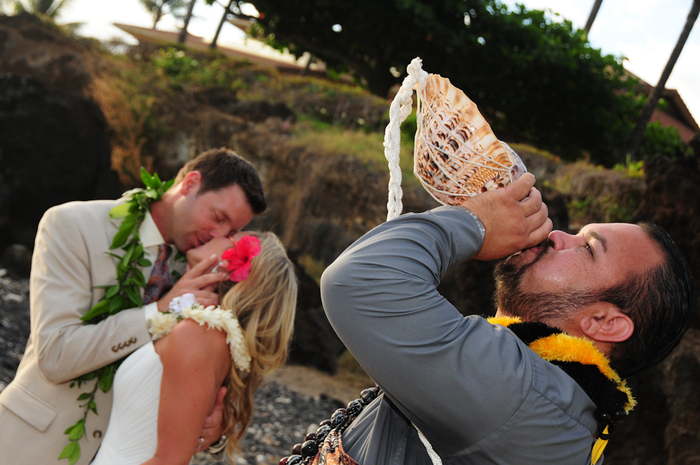 Conch shell blowing as couple kiss