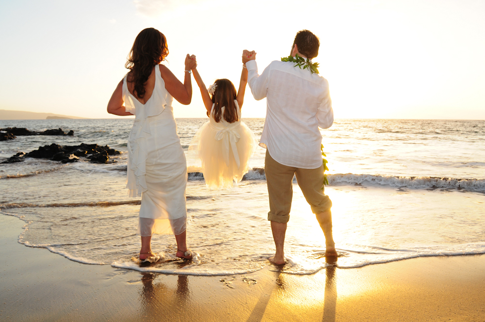 Couple with daughter at thei Maui beach wedding